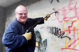 Rob Ford spray washing graffiti in Toronto